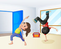 A girl and a boy dancing Stock Images