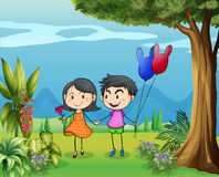 A girl and a boy dating in the garden Royalty Free Stock Images