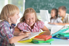 Girl and boy doing lessons Stock Photography