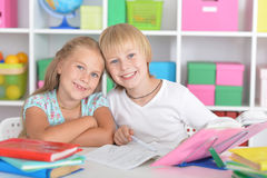 Girl and boy doing lessons Stock Photo