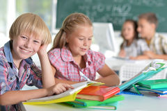 Girl and boy doing lessons Royalty Free Stock Photo