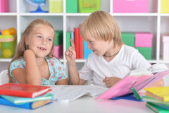 Girl and boy doing lessons Stock Image
