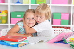 Girl and boy doing lessons Stock Photos