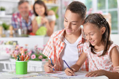 Girl and boy drawing. Little girl and boy drawing with pencils Stock Photo