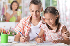 Girl and boy drawing. Little girl and boy drawing with pencils Royalty Free Stock Images