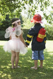 Girl And Boy Dressed As Fairy And Fireman Royalty Free Stock Photo