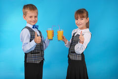 Girl and boy drink juice Stock Image