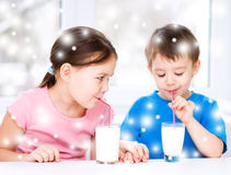 Girl and boy drink tasty fresh milk Royalty Free Stock Image