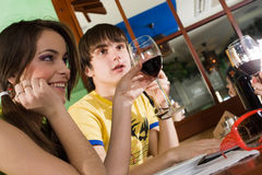 Girl and boy drink wine Stock Images