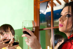 Girl with boy drink wine Stock Photos