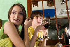 Girl and boy are drinking wine Royalty Free Stock Photo