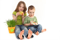 Girl and boy with Easter decoration Stock Photos