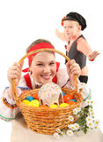 Girl and boy with Easter eggs and a holiday cake Stock Photo