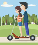 Girl and boy on electric scooter at the city Stock Photography