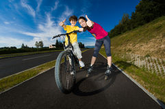 Girl and boy exercising outdoor Stock Images