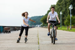 Girl and boy exercising outdoor Royalty Free Stock Photography