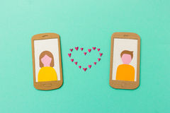 Girl and boy falling in love via smartphone Royalty Free Stock Images
