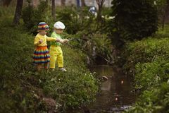 Girl and boy fishing at small river Stock Photography