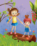 A girl and a boy in the forest Stock Images
