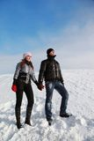 Girl and boy friend have rest in mountains Stock Images