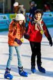 girl and a boy friend on the rink Royalty Free Stock Photo