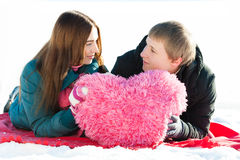 Girl and Boy with fur heart. On snow Royalty Free Stock Photos