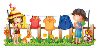 A girl and a boy in the garden with the hanging clothes Royalty Free Stock Photo