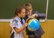 Girl and boy with globe Stock Image