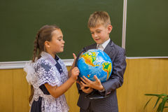 Girl and boy with globe Stock Photography