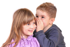 Girl and a boy gossiping royalty free stock photography