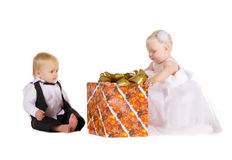 Girl and boy  with a great gift Stock Photography