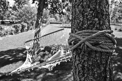 Girl and Boy on Hammock Grayscale Photo Royalty Free Stock Photos