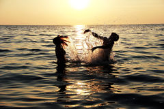 Girl and boy having fun, swimming in the sea Royalty Free Stock Image