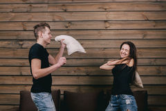 Girl and boy having pillow fight Royalty Free Stock Photos