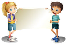 A girl and a boy holding an empty banner Stock Images