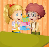 A girl and a boy holding gifts Stock Image