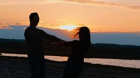 Girl and boy holding hands circling slow motion video stock footage