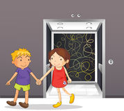 A girl and a boy holding hands near the elevator Stock Images