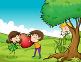 A girl and a boy holding a red heart Royalty Free Stock Photography