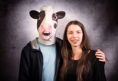 Girl and boy with  horse head. Strange couple concept. Studio shot on grey background Stock Images