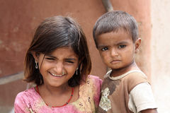 Girl and boy in india. A color photo of an older girl with a little boy. The photo was taken in India Royalty Free Stock Photo