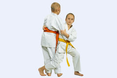 Girl and boy in judogi are training throwing Royalty Free Stock Photography