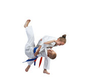 Girl and boy in judogi are the training throws Stock Photos