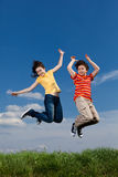 Girl and boy jumping Royalty Free Stock Images