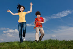 Girl and boy jumping Royalty Free Stock Photo