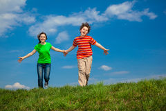 Girl and boy jumping Royalty Free Stock Photography