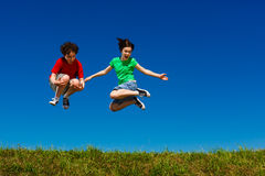 Girl and boy jumping Stock Photography