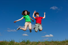 Girl and boy jumping Stock Photo