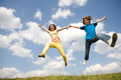 Girl and boy jumping. Soft focus. Focus on eyes Royalty Free Stock Photo