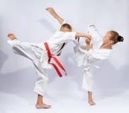 Girl and boy in karategi beats blows karate Stock Image